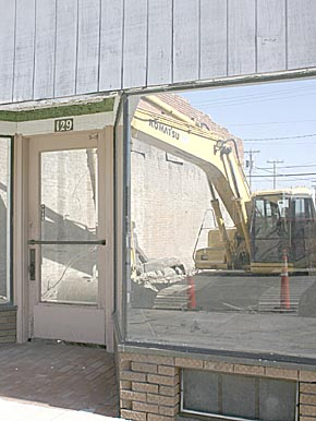 Downtown building comes down