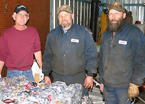 Paul Schilousky, left, with new owners Mike Landauer and Curt Berglund.