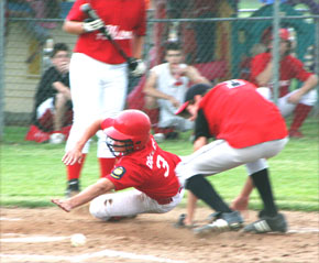 Dusty Dozler slides home safely for Albion Juniors
