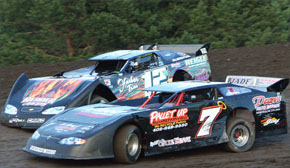 James Kelley (7) battles Nick Wehrle (12W) in LM racing