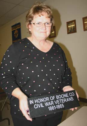 Karen Hagemann displays one of the memorial bricks available for purchase in the Vets Club building drive.