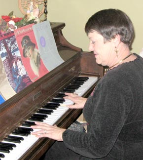 Pat Boilesen provides piano music during the Historical Society open house.