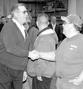 Charlie Meis shakes hands with Lindsay Corp. employees during his retirement reception.