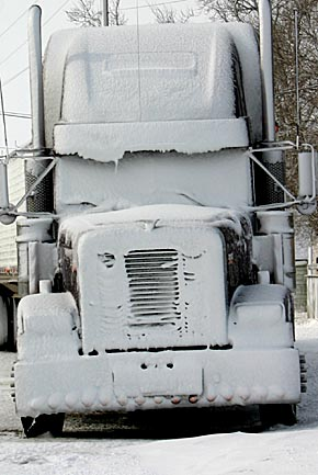Snow-caked semi in Albion