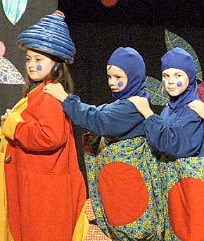 Children form a caterpillar in Saturday's production.