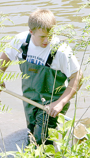 Student in search of amphibians at Olson Nature Preserve.