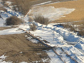 Big drifts and one-lane roads, like this example west of Albion, are common in Boone County.