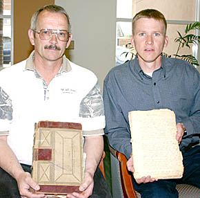 Chuck Rolf and Mike Grape with original Boone County Agricultural Society documents.