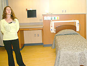 Tara Leetch, RN, greeted visitors in one of the newly furnished patient rooms.