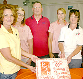Helping serve the barbecue were Petersburg State Bank staff members, l. to r., Angie Koch, Radene Temme, Allen Thorberg, Angie Simonsn and Ev Stokes.