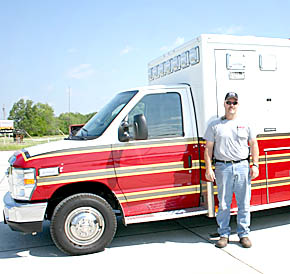 Fire Chief Bruce Benne with new Albion Fire/Rescue ambulance.