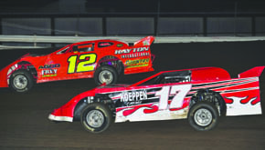 Mark Lueken (12) and Mike Kelley (17) battle in LM A Feature
