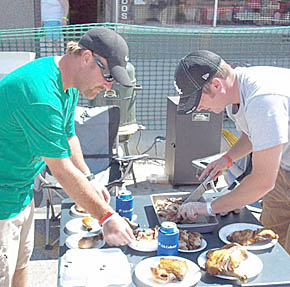 Casey Slaymaker and James Kunzman prepare to serve meat from their grill during Rhythm 'n Ribs.