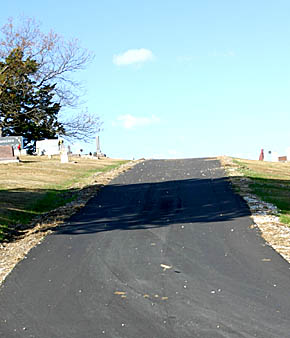 Newly paved road at Rose Hill Cemetery