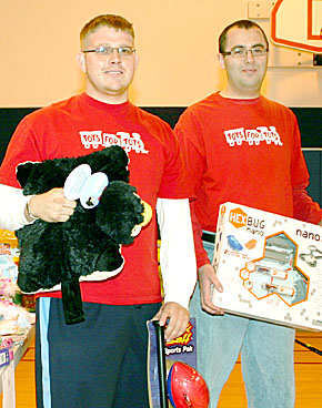 Tim Casper, left, and Mike Mapel with toys for area children.