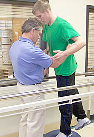 Jim Meyer, a physical therapist at Boone County Health Center, works with Marine L. Cpl. Neal Claar of Petersburg.