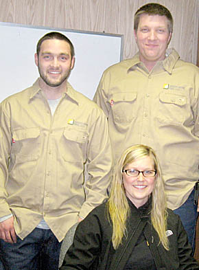Laredo Ridge wind farm employees, standing (l. to r.) Matt Winter and Kyle Fritz; seated, Ashley Thieman.
