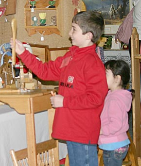 Youngsters look over the wares in an exhibit of wood products at the Home, Farm & Garden Show.
