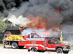 Fire engulfs greenhouses at Schrad's Nursery.
