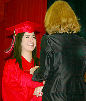 Boone Central graduate Mariana Moncada accepts her diploma from School Board President Karen Kayton.