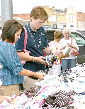 Shoppers at Albion sidewalk sales.