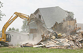Demolition of vacant home at 7th and Marengo.