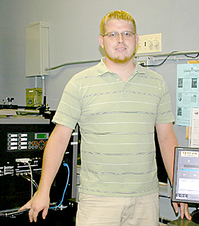 Tim Casper, summer manager at Gateway Theatre, with new digital projection equipment.