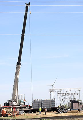 A crane off-loads a large radiator to be installed at the TPW substation.