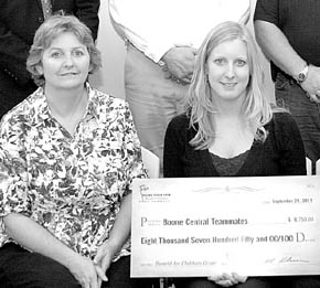Jeanette Zwiener, coordinator, and Shannon Landauer, president, with donation from Valero Renewables to Boone Central TeamMates.