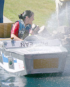 Tonya Hunt, float-a-boat winner, gets a good soaking.