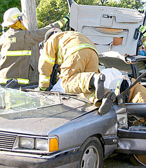 Firemen assist victims in last Friday's simulated accident.