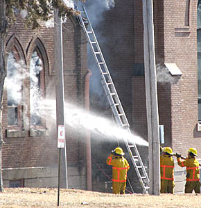 Firemen spray water into the window of the west sacristy at St. Michael's Church in Spalding.