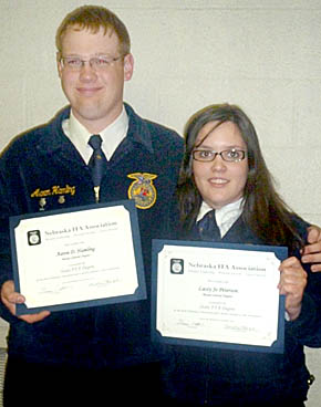 Aaron Hamling, left, and Lacy Jo Peterson with State FFA degrees.