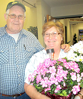 Caring Kind employee LaVonne Carlson, right, with her husband, Warren.