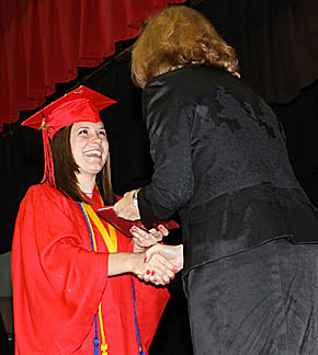 Boone Central graduate Gina Nelson accepts her diploma from School Board President Karen Kayton.