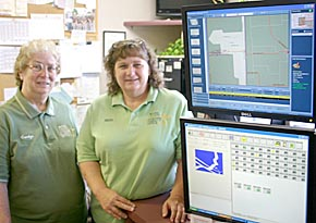 Sheriff's office employees Carolyn Beckman and Sheryl Machacek, communications director, with computer monitors showing new mapping technology.