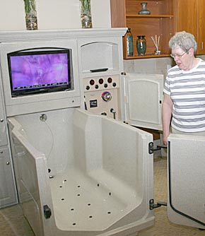 Shirley Babcock checks out a spa tub in the new wing at GSS-Albion Wolf Home.