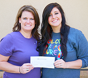 Amanda Lipker, right, presents check to Aprill Murphy, director of the Boone County Health Center Foundation.