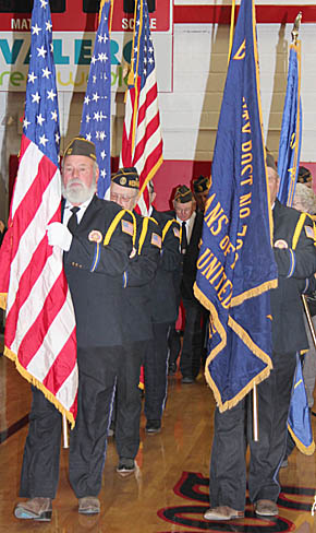 Veterans march into the Boone Central Gym Monday to post the colors.