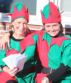 Santa's elves greet shoppers in downtown Albion.