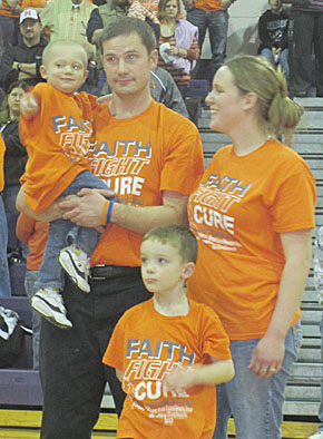 Justin and Jenni DeWitt with sons Cooper and Tony at the 'Orange Out.'