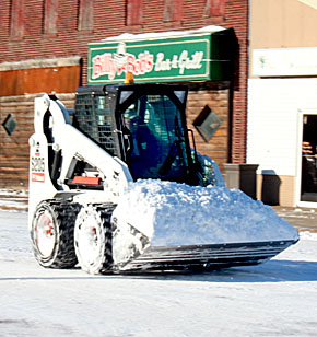 Moving snow downtown after the Dec. 19-20 storm.