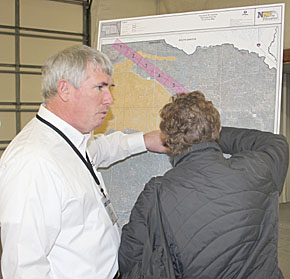 NDEQ staffer discusses the proposed Keystone XL pipeline location with an area resident.