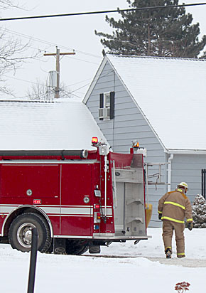 Firemen arrive at Sherrill home on Dec. 27.