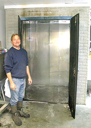 Larry Swerczek with new smoker at Albion Locker