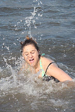 A Polar Bear Dip participant reacts to the chilly water temperature Saturday.