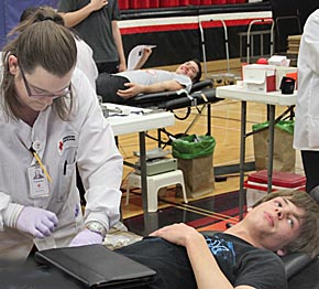 Tanner Mazour gives blood during the Bloodmobile visit to Boone Central Schools last Friday.