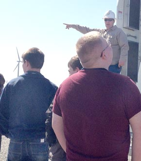 Matt Winter, manager of Loredo Ridge Wind Farm, explains wind energy operations to students.