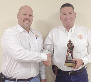 Albion Fire Chief Bruce Benne, left, presents 30-year award to Jim Schindel.