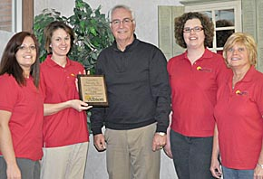 Ralph Schmadeke honored for 40 years in business.